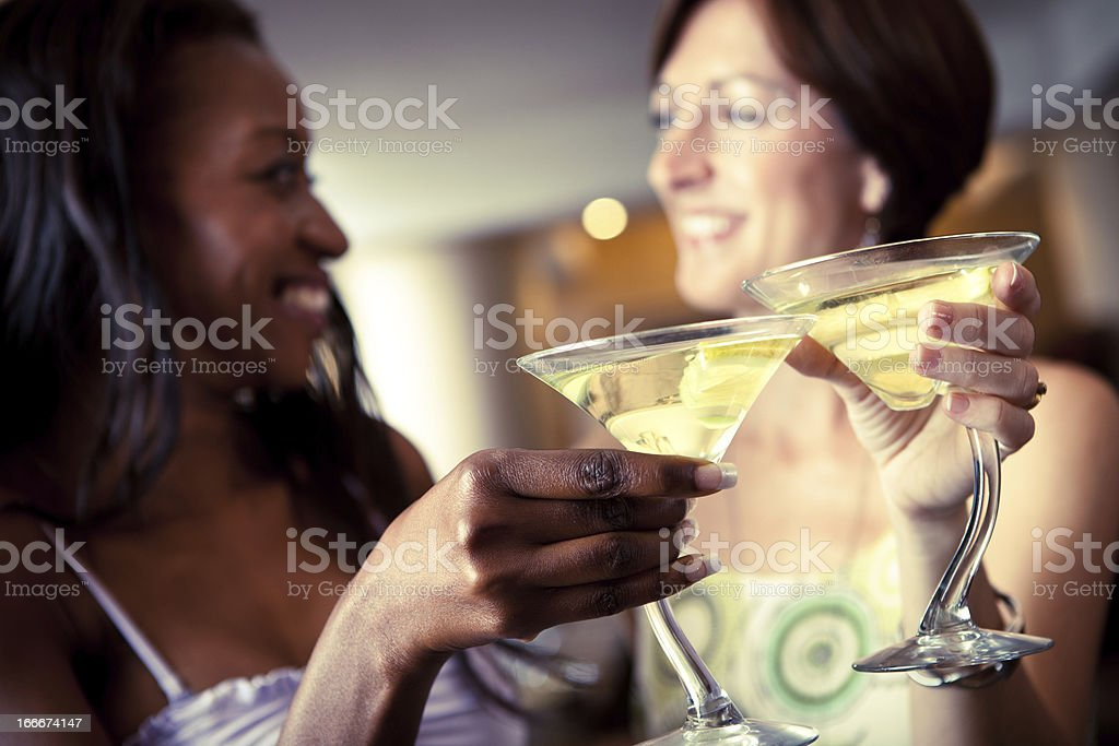 Two women having drinks stock photo