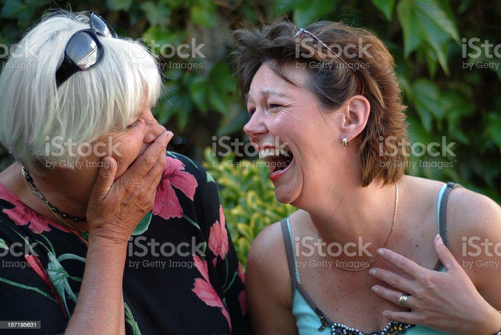 Two women having fun and laughing stock photo