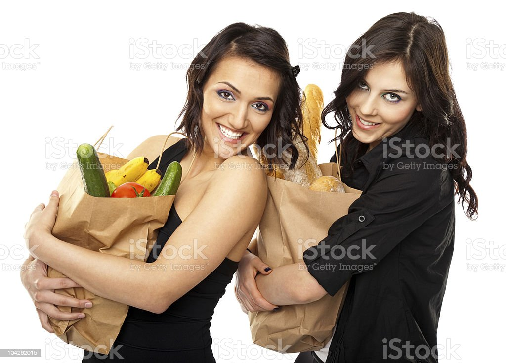 Two women holding groceries royalty-free stock photo