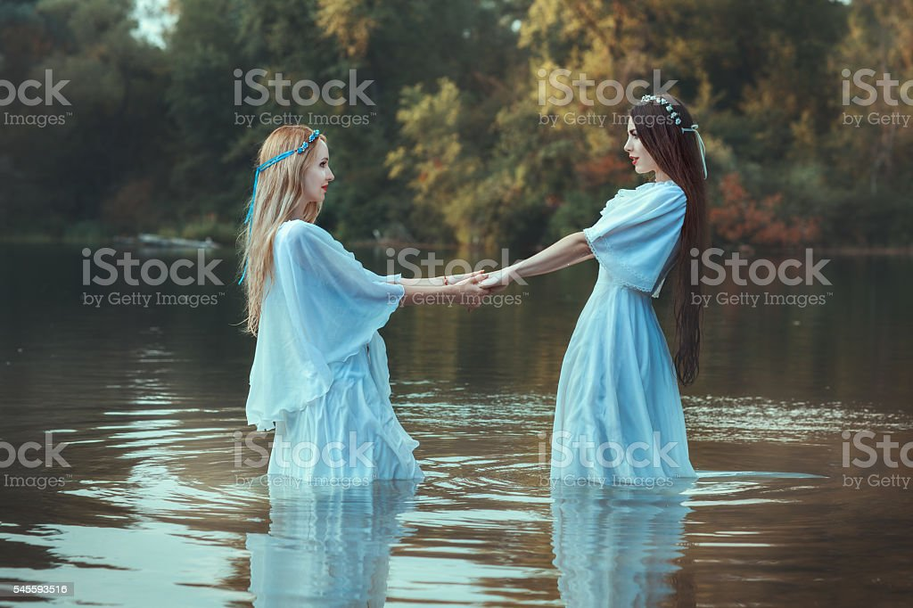 Two women holding hands. stock photo