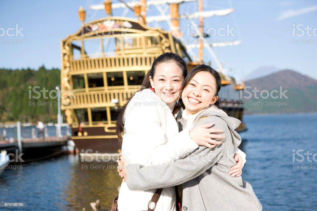 Two women hugging royalty-free stock photo