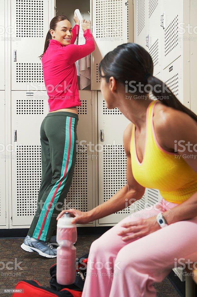 Two women in a locker room stock photo