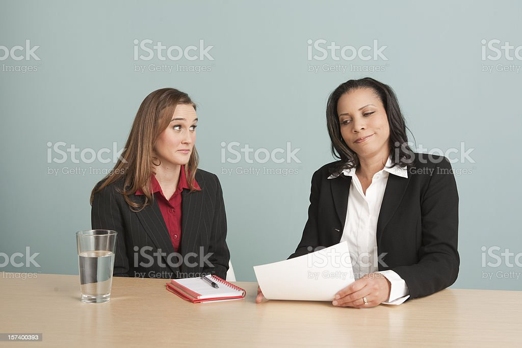 Two women in a one-on-one: sorry, no pay raise! royalty-free stock photo