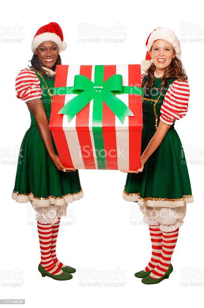 Two women in costume holding a Christmas present stock photo