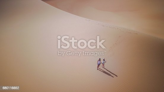 istock Two women in dunes from a drone. 680116652