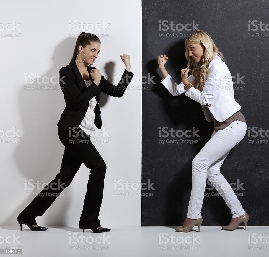 Two women in fighting pose stock photo