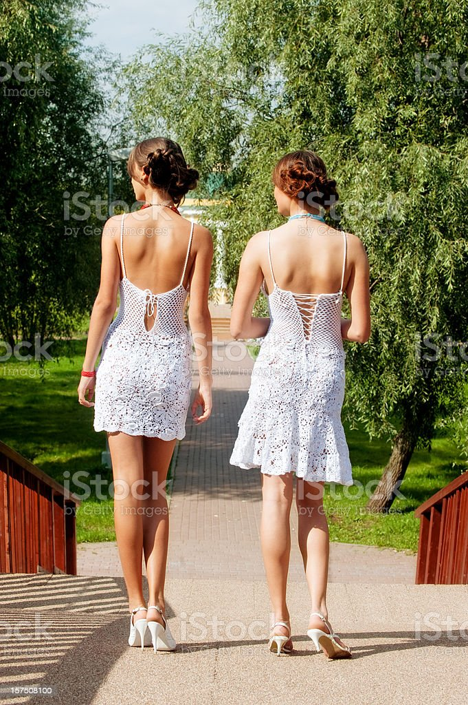 Two women in white dress,rear view royalty-free stock photo