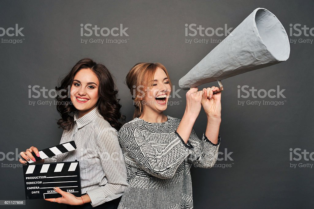 two women inform about the beginning of shooting stock photo