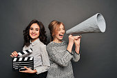 istock two women inform about the beginning of shooting 621127918