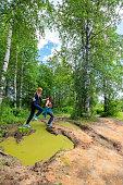 Two women having fun in the Kamenny Gorod National Park, Perm Region, Russia. Nikon D850.