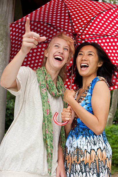 Two women looking and smiling stock photo