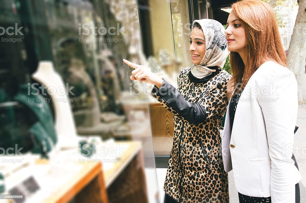 Two Women Looking At A Jewelry Store Window stock photo