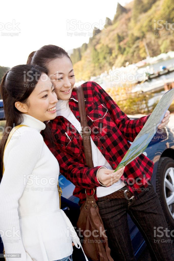 Two women looking at map royalty-free stock photo