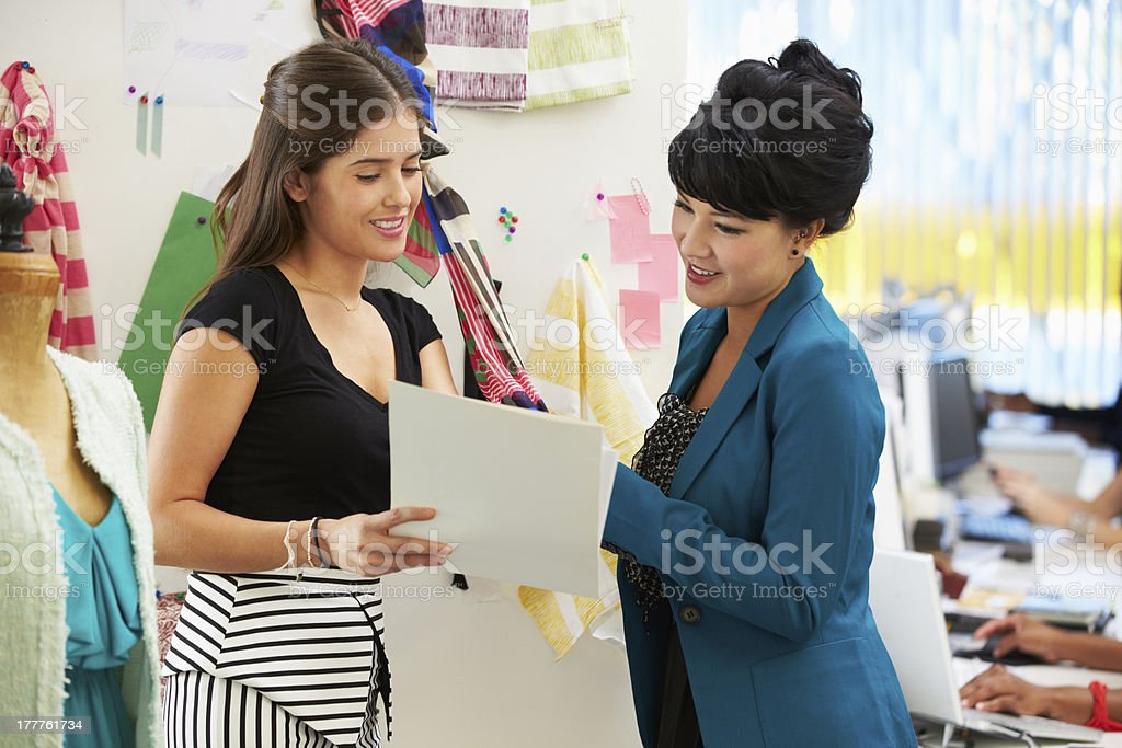 Two Women Meeting In Fashion Design Studio royalty-free stock photo