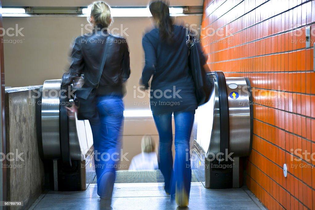 Two women on escalator royalty-free stock photo