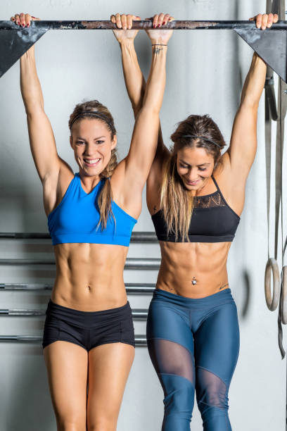 Two women on gymnastic bar stock photo