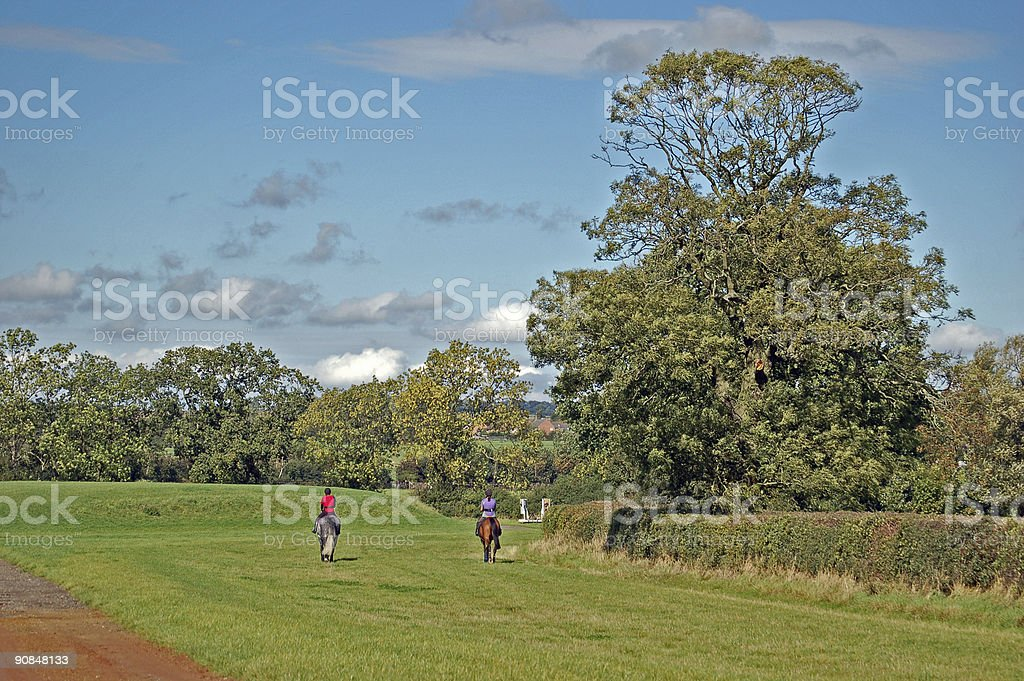 Two women on horses out for a Morning hack royalty-free stock photo