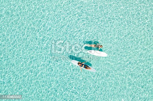 Two Women on Paddle Board in Blue Ocean, Maldives