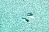 Two Women on Paddle Board in Blue Ocean, Maldives