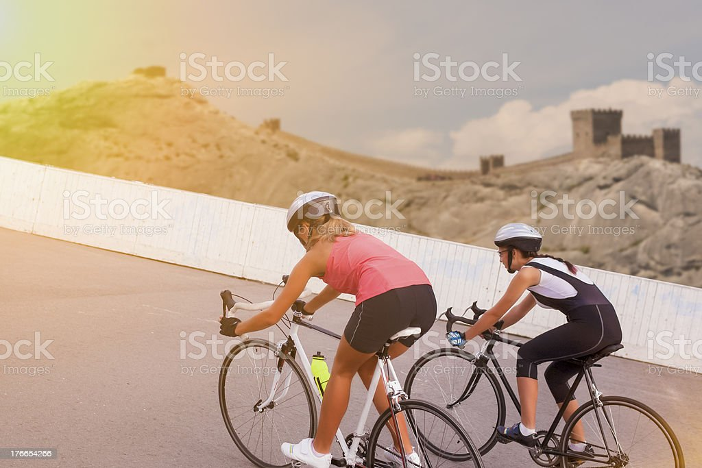 two women on race bikes. composite image royalty-free stock photo