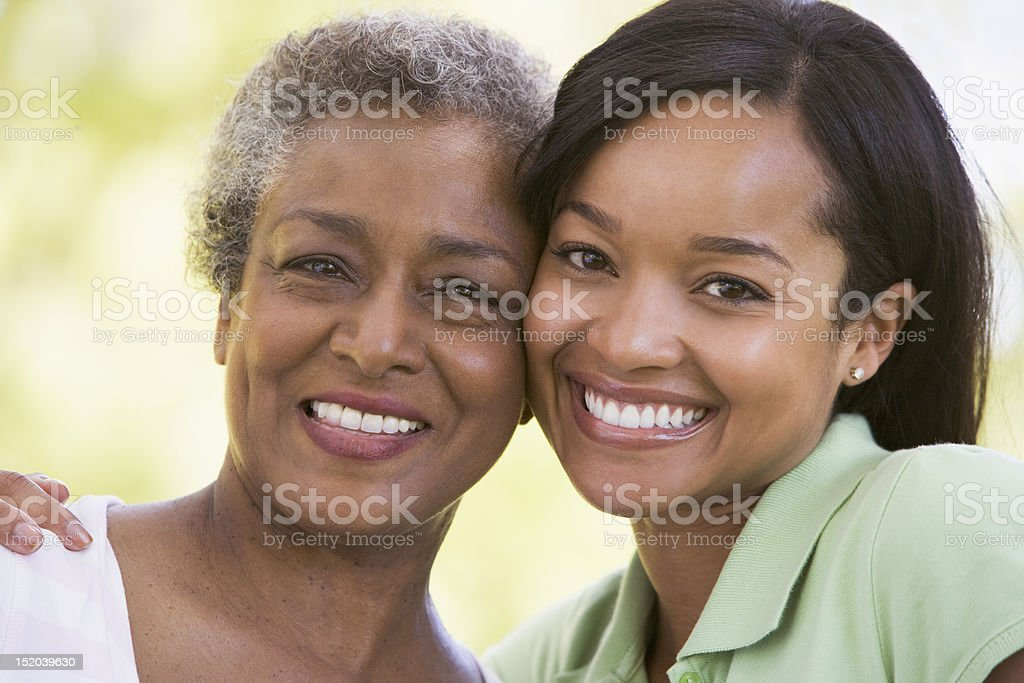 Two women outdoors smiling stock photo