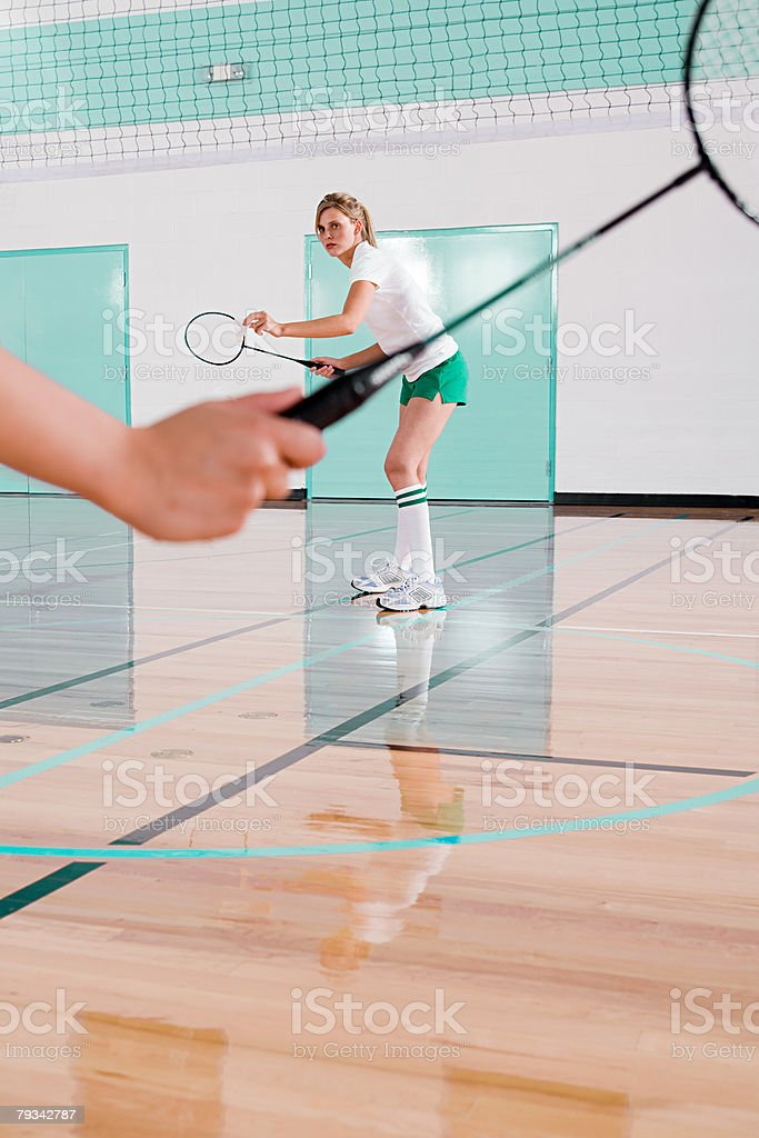 Two women playing badminton stock photo