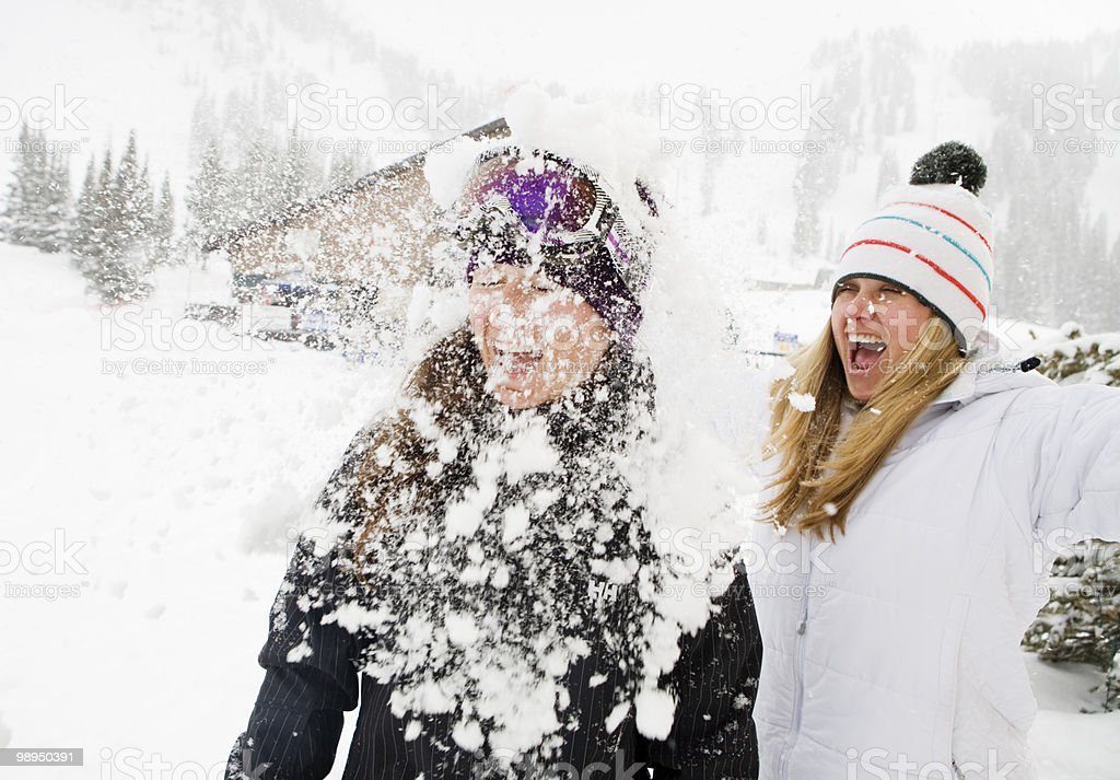 Two women playing in the snow. foto royalty-free