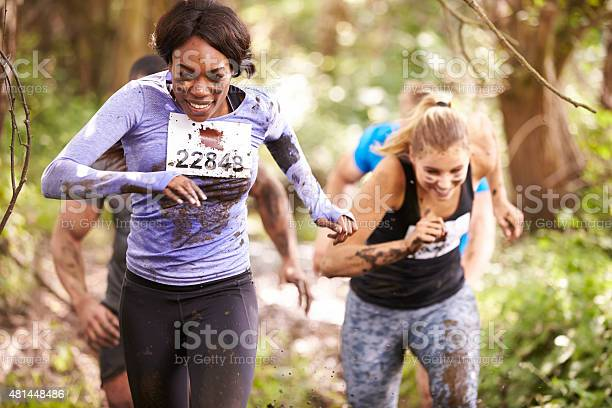 Two Women Running In A Forest At An Endurance Event Stock Photo - Download Image Now
