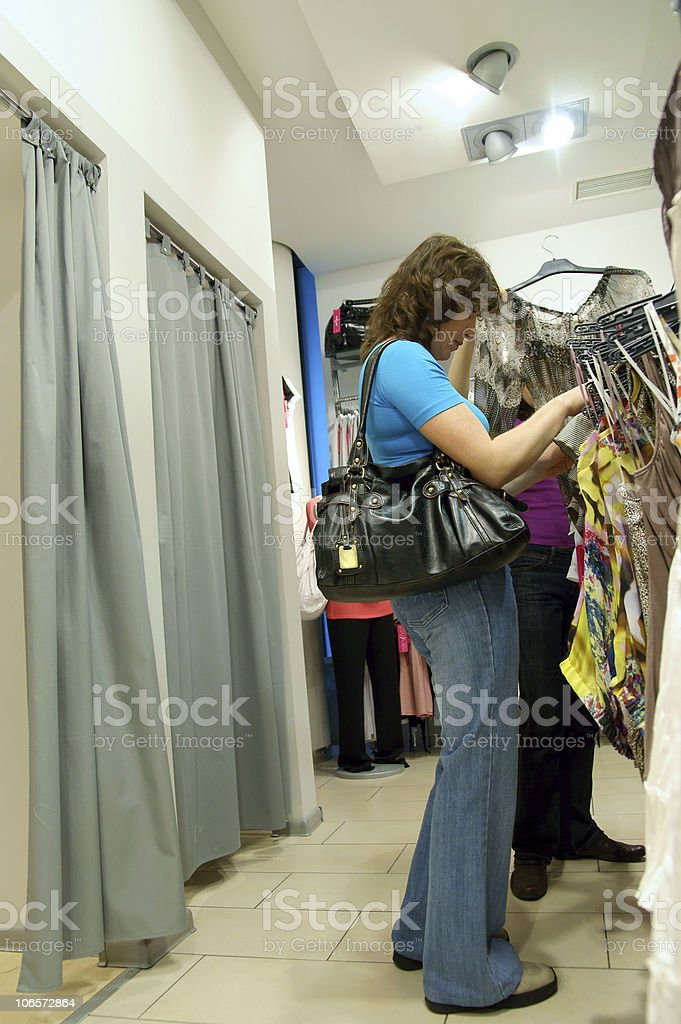 two women shopping clothes in shop royalty-free stock photo