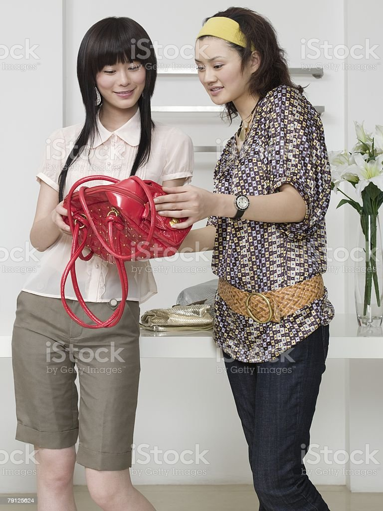 Two women shopping for handbags royalty-free 스톡 사진