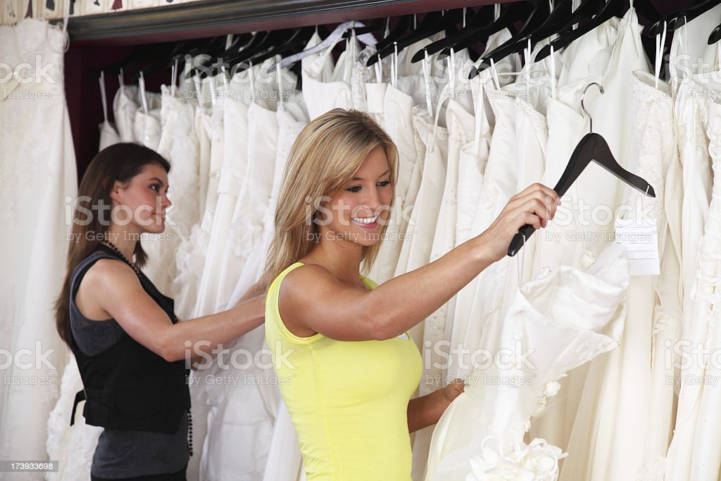 Two Women Shopping For Wedding Dress royalty-free stock photo