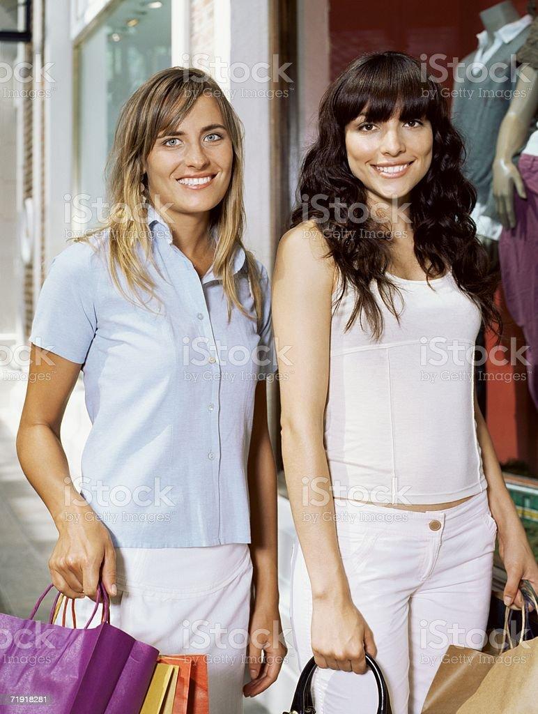 Two women shopping royalty-free stock photo