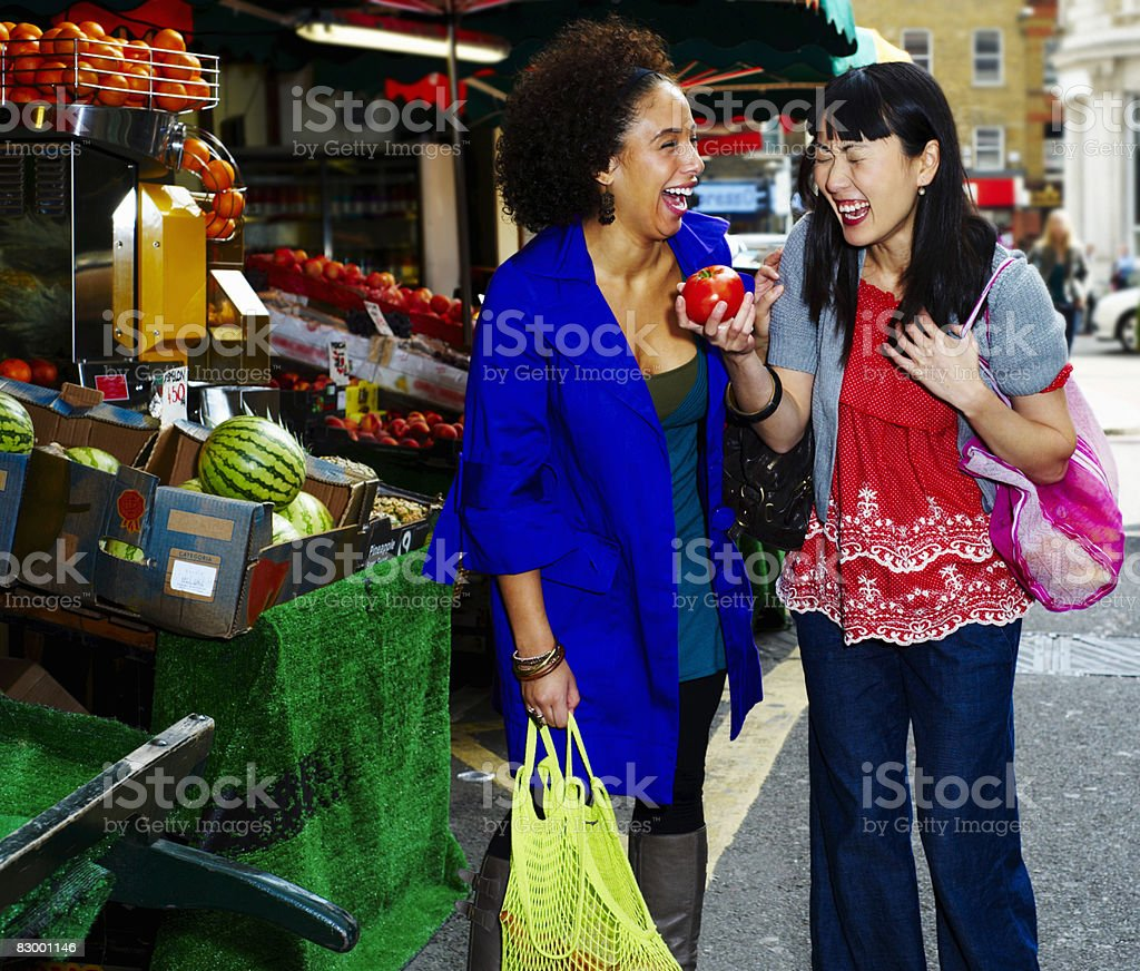 Two women shopping royalty free stockfoto