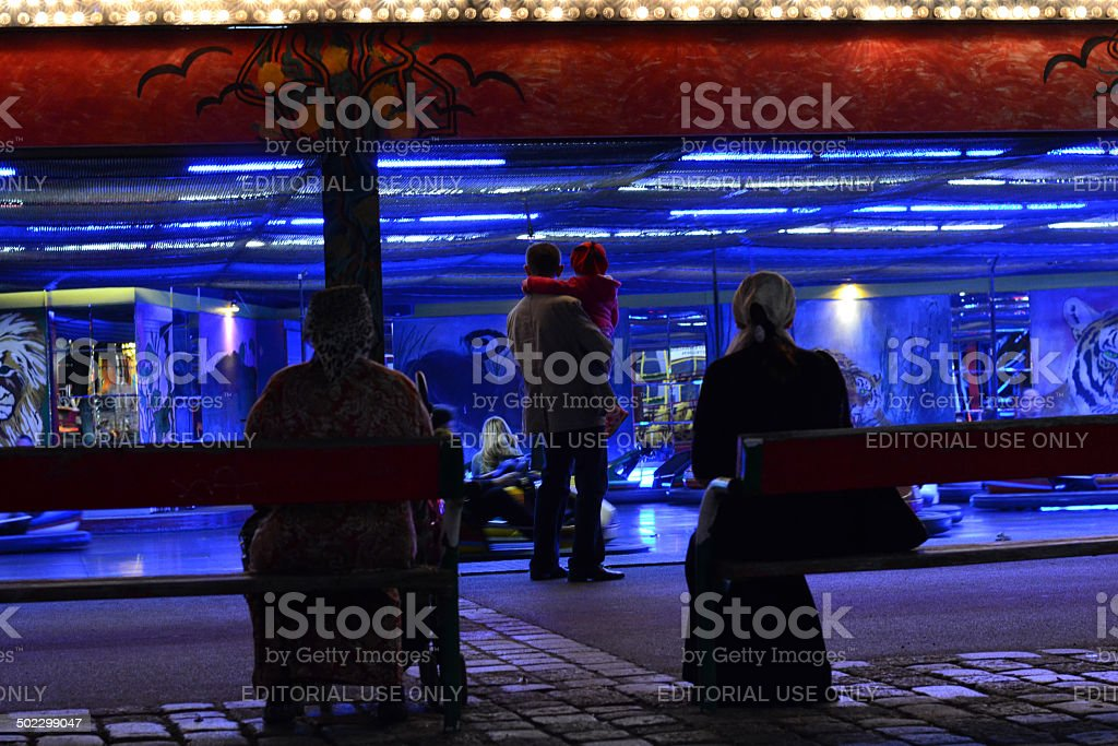 Two women sitting in front of bumper car stock photo