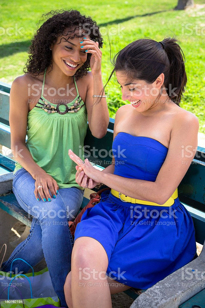 Two Women Smile at Engagement Ring stock photo