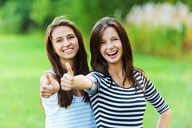 Two women smiles hand front stock photo