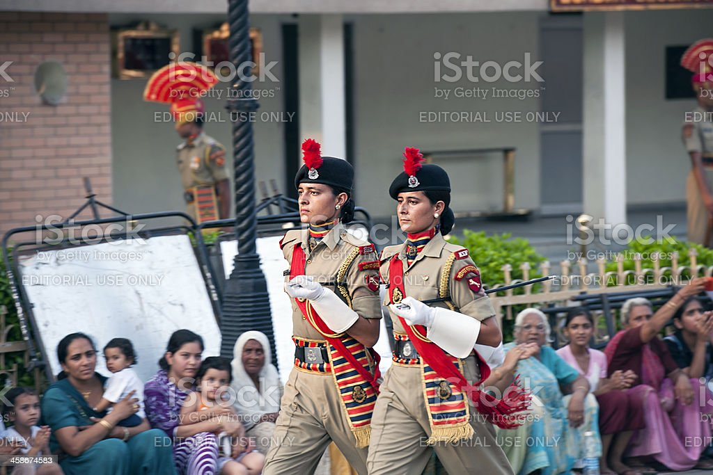 Two Women Soldiers Marching India-Pakistani Border stock photo