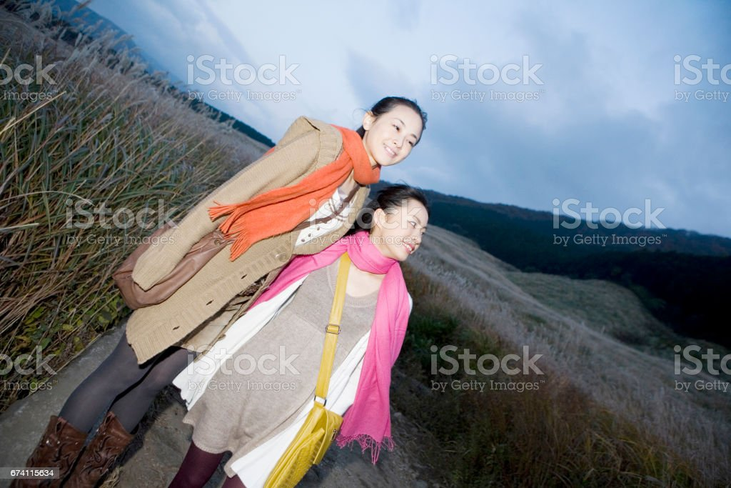 Two women stand to the Susukino Green royalty-free stock photo