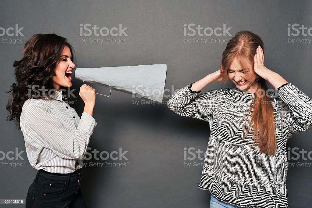 two women swear stock photo