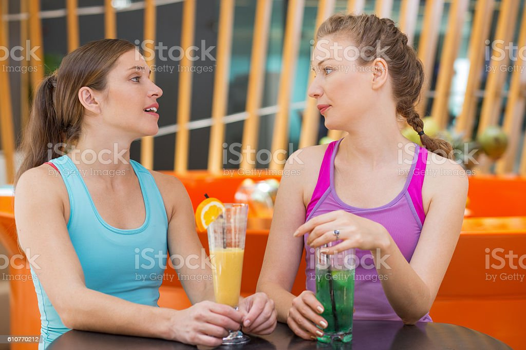 Two Women Talking in Sport Cafe after Training stock photo