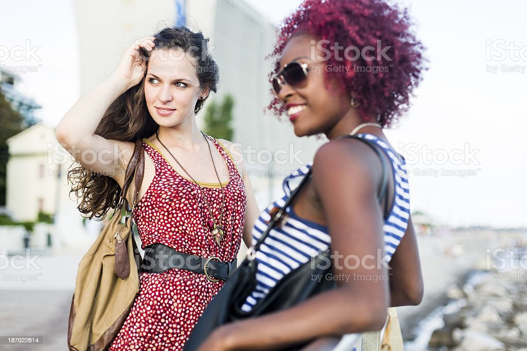 Two women talking outdoor royalty-free stock photo