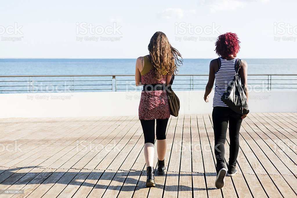 Two women talking outdoor royalty-free stock photo