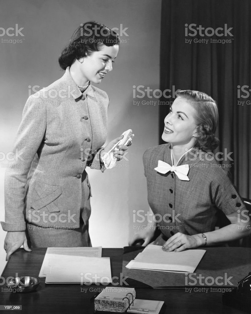 Two women talking royalty-free stock photo