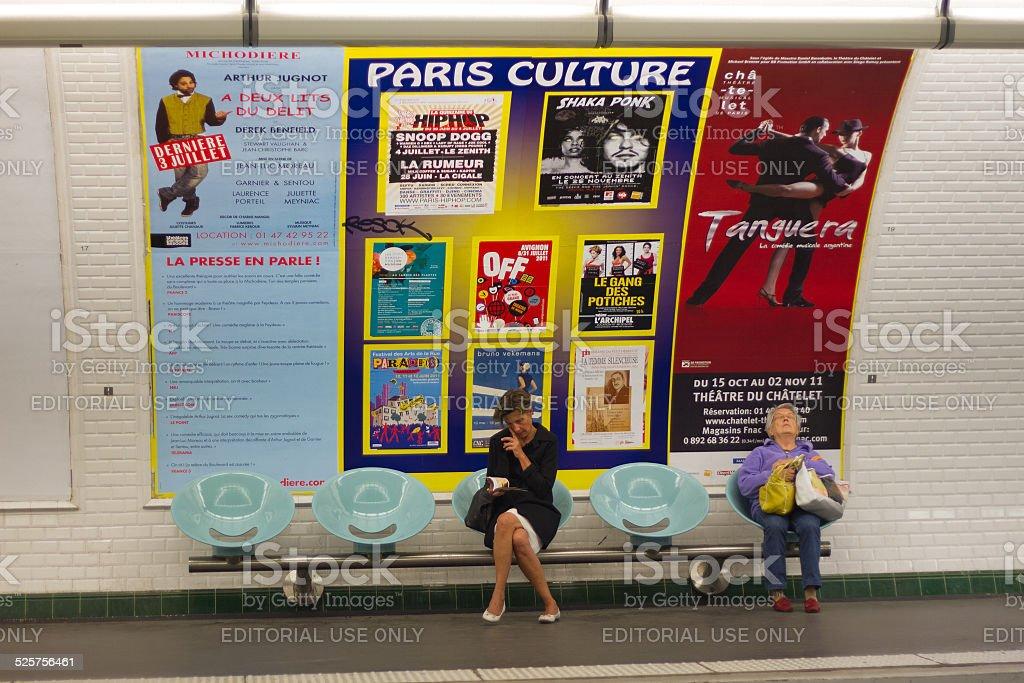 Two Women Wait in the Paris Metro Underground stock photo
