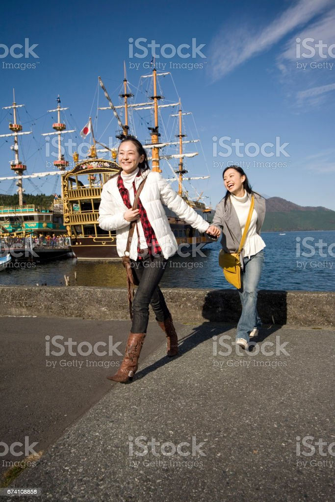 Two women walk around the Lake royalty-free stock photo