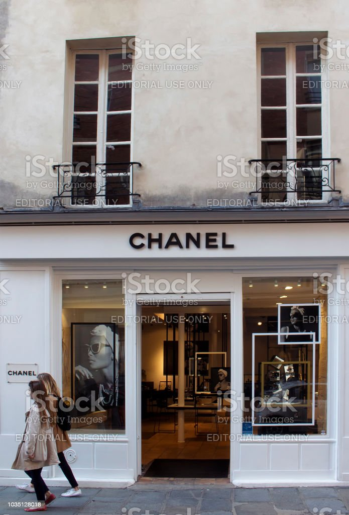 Two Women Walk By A Store Of Famous International French Luxury ... ee922ddc7
