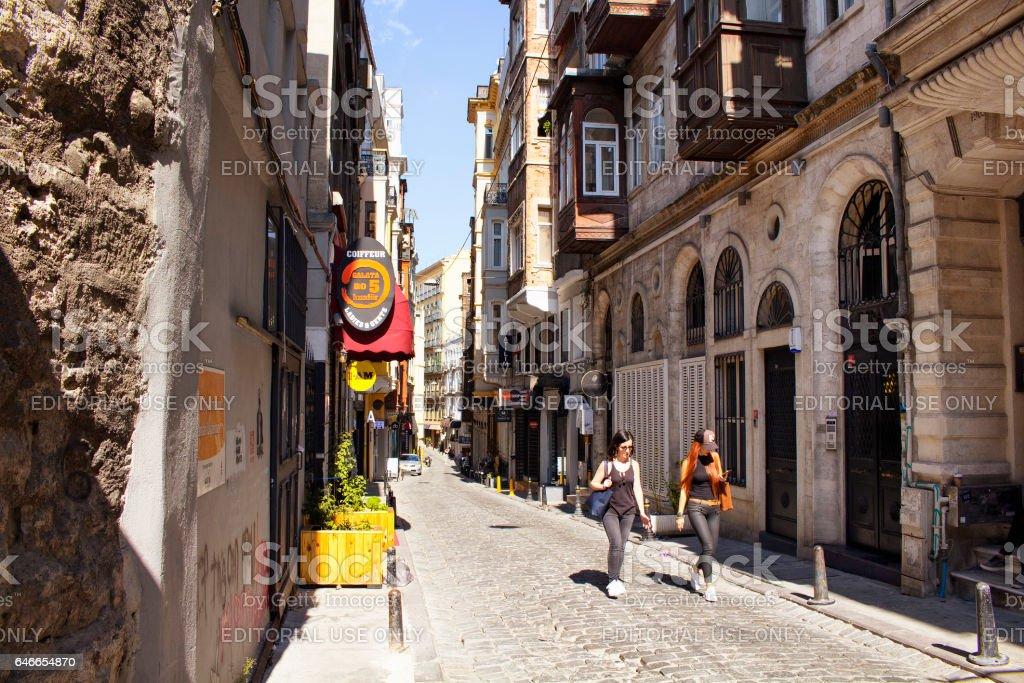 Two women walk on Serdar-i Ekrem street in Galata area stock photo