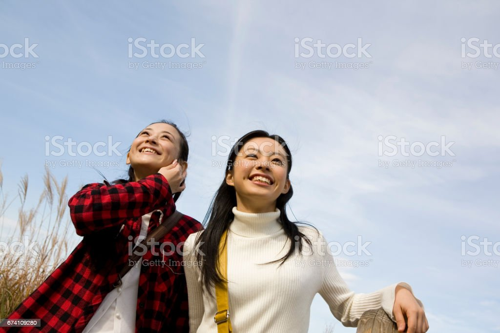 Two women walk through attraction royalty-free stock photo