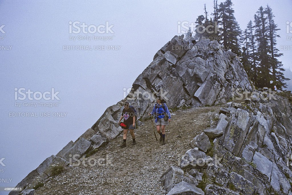 Two Hikers Walk the Pacific Crest Trail in Fog stock photo