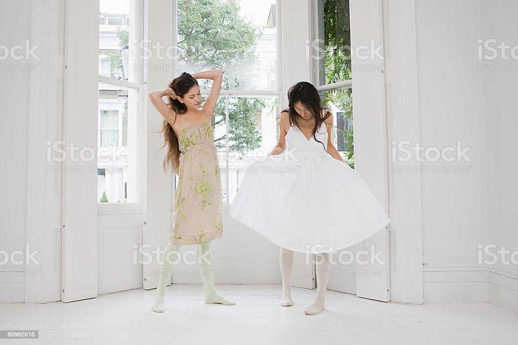 Two women wearing dresses 免版稅 stock photo